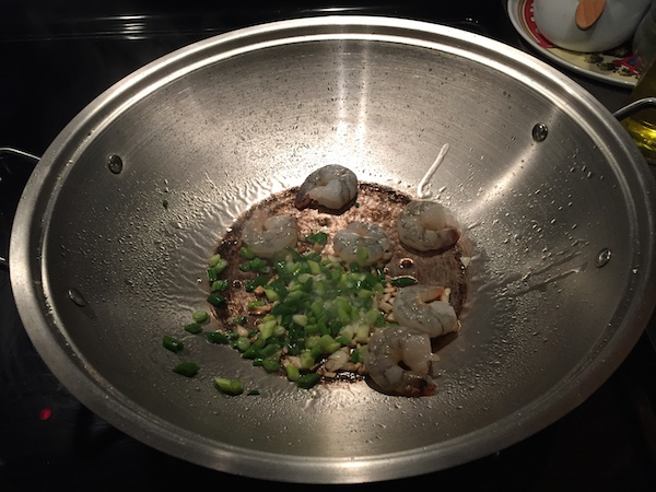 Frying shrimp in a wok
